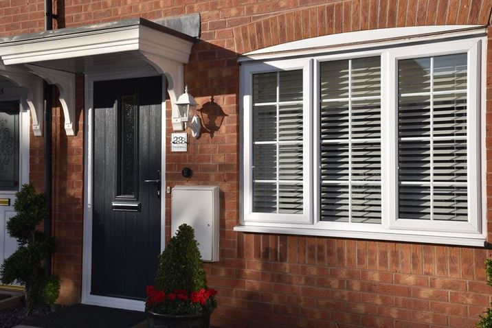 White uPVC window with a black composite door in margate